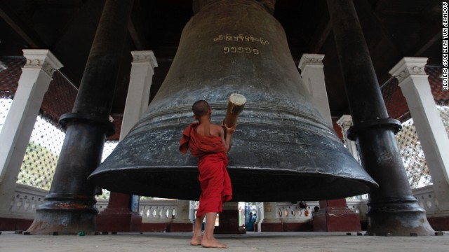 A novice monk rings the Mingun Bell, the world's third-largest bell, in Mingun village, about 21 kilometers (13 miles) southwest of Mandalay.