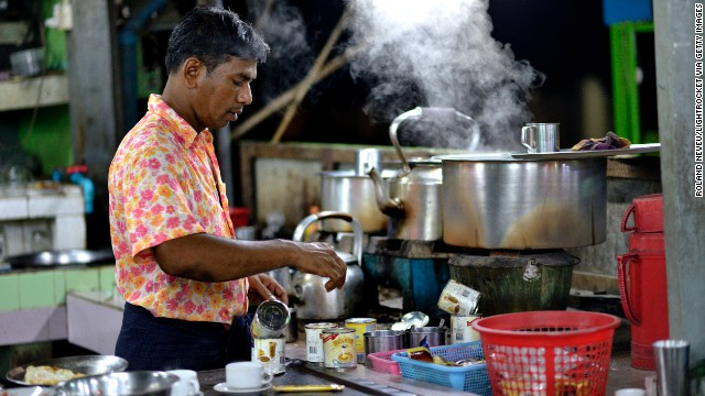 A Burmese man of Indian descent makes tea in a stall in Mawlamyine.
