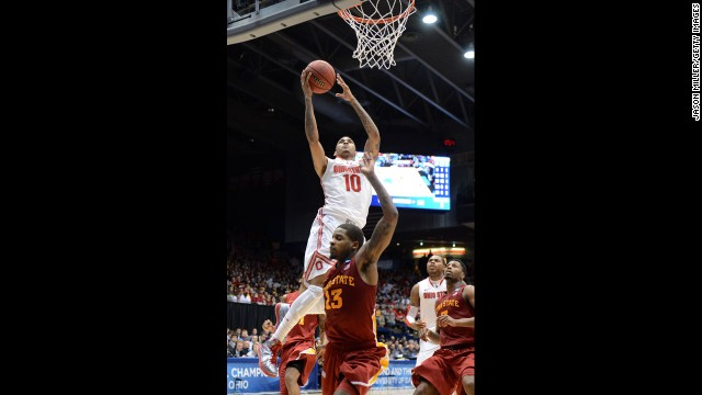 LaQuinton Ross of Ohio State drives to the basket against Korie Lucious, bottom center, of Iowa State on March 24.