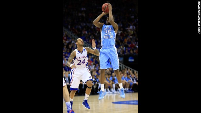 Reggie Bullock of North Carolina attempts a shot against Travis Releford of Kansas on March 24.