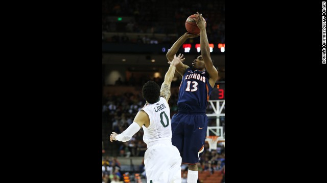 Tracy Abrams of Illinois shoots over Shane Larkin of Miami on March 24.