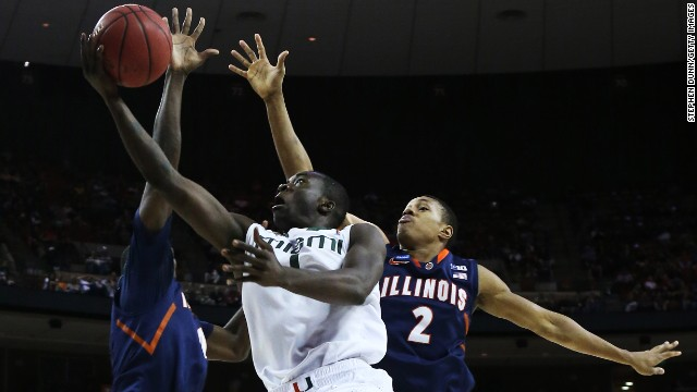 Durand Scott of Miami shoots against Joseph Bertrand of Illinois on March 24.