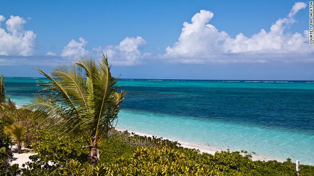 Visitors to Turks and Caicos mingle more often with tropical fish than they do with locals -- that's changing.