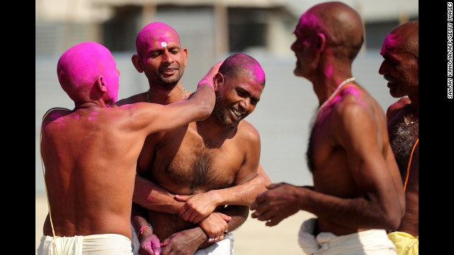 Bihari Hindu priests smear colored powder on each other after a ritual at the Sangam on March 6.