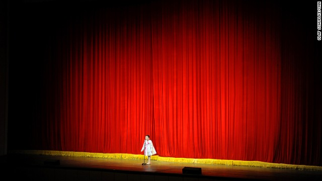 A North Korean girl stands onstage at Mangyongdae School Children's Palace during a showcase of student talents.