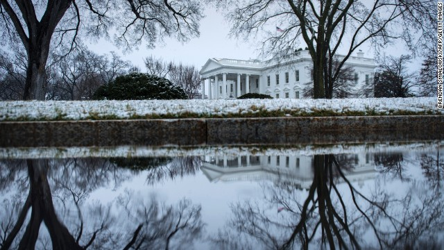 Snow covers the shrubbery around the White House on Monday, March 25.