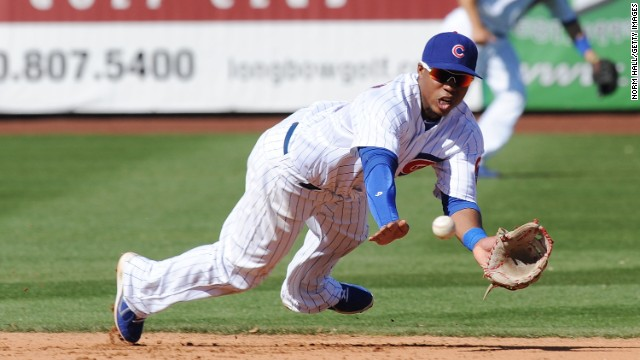 Luis Valbuena of the Chicago Cubs makes a diving catch against the Arizona Diamondbacks during a spring training game on March 1 at Hohokam Stadium in Mesa, Arizona.