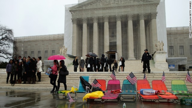 Colorful beach chairs lined up by demonstrators sit in front of the U.S. Supreme Court on Monday, March 25, in Washington.