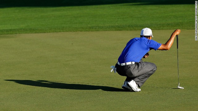 Woods lines up his putt at the Honda Classic at PGA National in March 2012. He shot a 62, his lowest final round as a professional, at the Honda Classic, but he tied for second in the tournament.