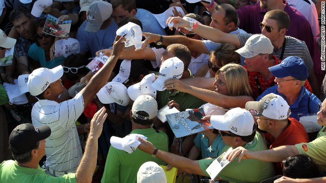 Woods signs autographs at the<a href='http://www.cnn.com/2012/03/25/sport/golf/golf-arnold-palmer-tiger/index.html '> Arnold Palmer Invitational</a> in March 2012. His win there marked his first PGA tour victory since September 2009.