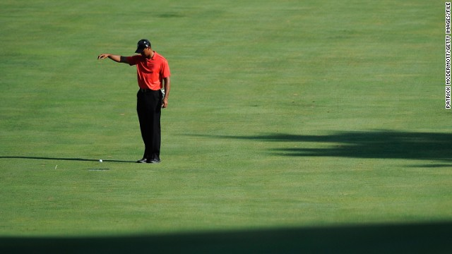 Woods drops the ball on the 15th fairway during the final round of the AT&T National in July 2012. <a href='http://www.cnn.com/2012/07/02/sport/golf/golf-woods-congressional-nicklaus/index.html'>He overtook Jack Nicklaus</a> for second place on the all-time PGA Tour list with his victory at the AT&T National.
