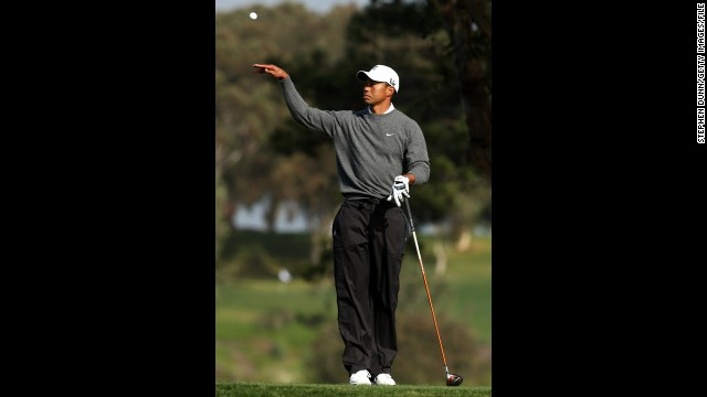 Woods tosses his ball to his caddie at the Farmers Insurance Open at Torrey Pines in January 2013. He started the new year in fine form by winning his 75th PGA Tour title in the Farmers Insurance Open.