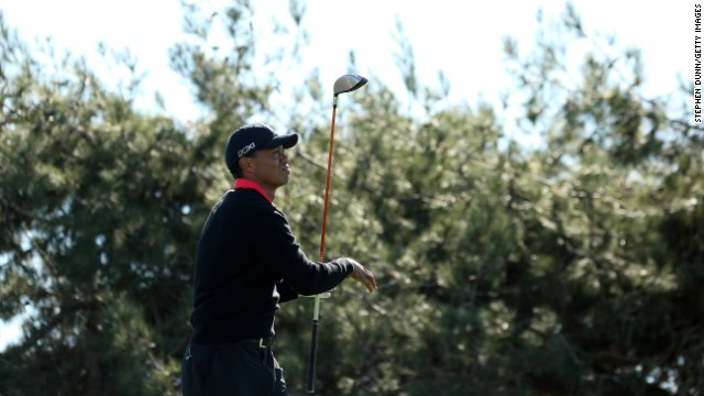 "Woods hits his tee shot on the 12th hole during the final round of the Farmers Insurance Open at Torrey Pines in January 2013. He lost his title the previous year as the world's top-paid athlete, dropping to third place on Sports Illustrated's ""Fortunate 50"" list."