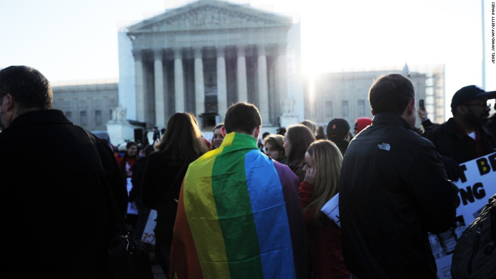 Supporters of same-sex marriage gather in front of the U.S. Supreme Court on Tuesday, March 26, in Washington. The justices heard arguments on California's Proposition 8, which bans same-sex marriage. Dozens of people camped out in hopes of attending the hearing, and rallies in support of same-sex marriage have been held throughout the country.