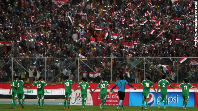 Iraqi team players celebrate after scoring a goal during their friendly soccer match against Syria in Baghdad.