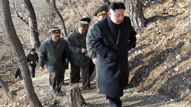 Kim, with North Korean soldiers, makes his way to an observation post on March 25.
