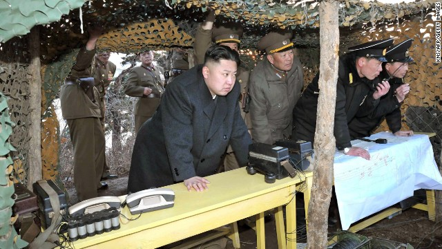 North Korean leader Kim Jong Un inspects drills by the Korean People's Army (KPA) Navy at an undisclosed location on North Korea's east coast in a photo from the state-run Korean Central News Agency taken on March 25, 2013.
