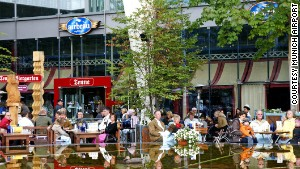 Travelers relax in Munich Airport\'s beer garden.