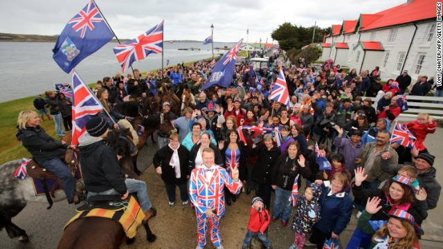 British residents in Falklands wave flags during a protest.