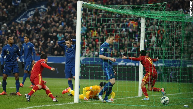 Pedro rushes out of the goalmouth after converting Nacho Monreal's cross to give the world champions a key win in Paris.