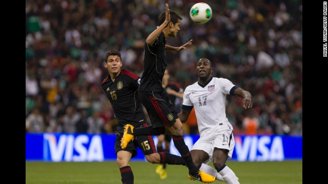 Diego Antonio Reyes jumps for the ball.