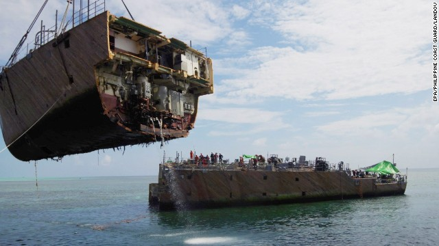 Grounded U.S. ship's bow lifted off reef