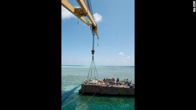 The crane vessel removes a hull section on Wednesday, March 27. The U.S. Navy expects the Guardian to be completely removed from Tubbataha Reef by mid-April, an official says.