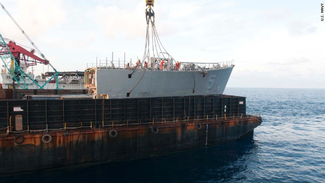 The crane vessel pulls the bow off the ship on March 26.