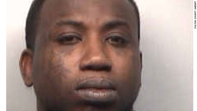 Rapper Gucci Mane, here in a March booking photo, has been charged in federal court with gun crimes.