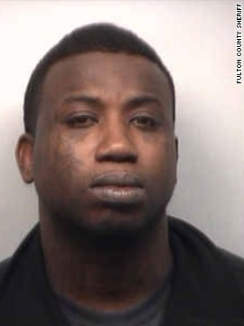 Rapper Gucci Mane turned himself in to authorities on March 26 after a warrant was issued for his arrest on aggravated assault charges in Atlanta.