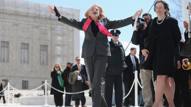 Edie acknowledges her supporters as she leaves the Supreme Court on March 27 after arguments in her case challenging the constitutionality of the Defense of Marriage Act.