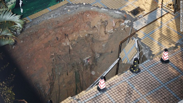  A sinkhole opened up and killed a guard in a construction site in Shenzhen, China's Guangdong province on Wednesday, March 27. The sinkhole might have been caused by heavy rains and the collapsing of old water pipes running beneath the surface, Shenzhen Special Zone Daily reported. Take a look at sinkholes throughout the world. 
