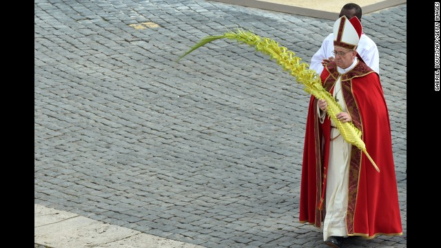 Pope Francis walks after blessing the palms on Palm Sunday, March 24.