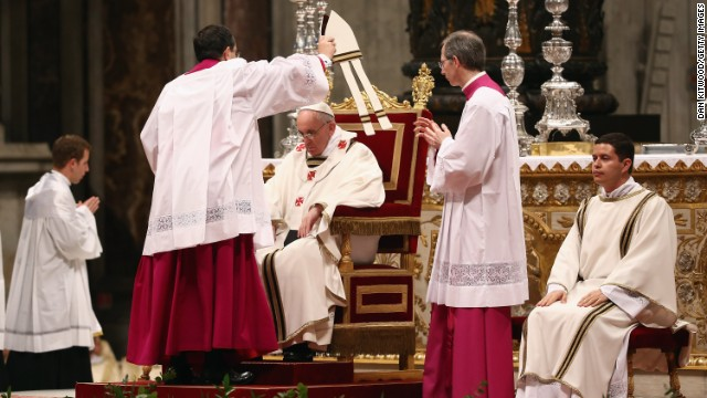 Pope Francis is crowned with his miter on Thursday.