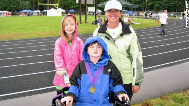 Karry Trout participates in a Relay for LIfe event with her daughters Lucy, 7, and Ella, 13.
