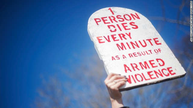 An Amnesty International demonstrator outside the White House urges strong support for the Arms Trade Treaty in 2013.