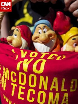 In one protest, campaigners placed garden gnomes on the steps of McDonald's office in the city of Melbourne.