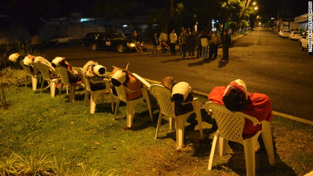 The bodies of seven men arranged in chairs are pictured in Uruapan, in the Mexican state of Michoacan, on March 23. The men were shot in the head with threat messages nailed to some of their chests using ice picks.