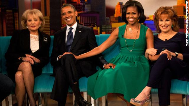 "Walters poses for a photo with President Barack Obama, first lady Michelle Obama and Joy Behar on the set of ""The View"" in September 2012 in New York."