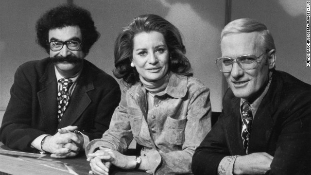 "From left, Gene Shalit, Walters, and Frank McGee sit behind the news desk in a promotional portrait for the ""Today Show"" in 1973."