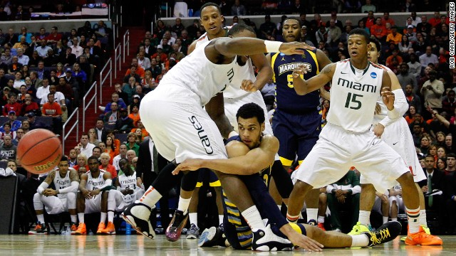 Trent Lockett of the Marquette Golden Eagles passes the ball from the ground against the Miami Hurricanes on March 28 in Washington.