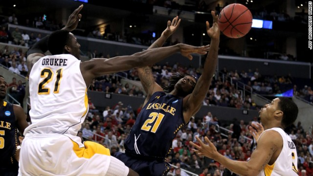 Tyrone Garland of the La Salle Explorers goes up for the ball against Ehimen Orukpe of the Wichita State Shockers on March 28 in Los Angeles.