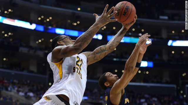 Carl Hall of Wichita State and Tyreek Duren of La Salle go after a loose ball on March 28 in Los Angeles.
