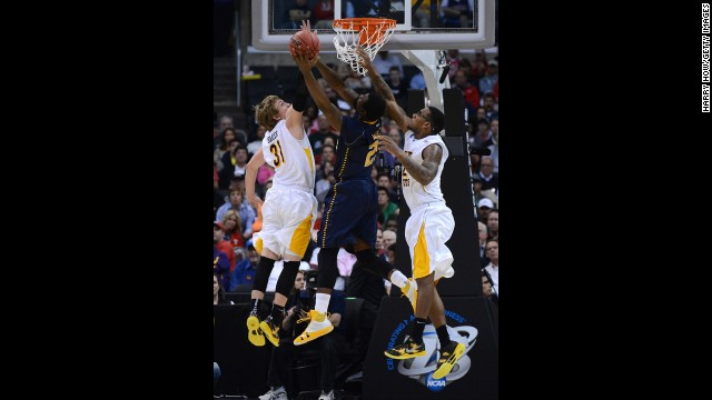 Jerrell Wright of La Salle goes up for a shot between Ron Baker, left, and Carl Hall, right, of Wichita State on March 28 in Los Angeles.