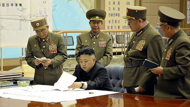 Kim Jong Un is briefed by his generals in this undated photo. On the wall is a map titled