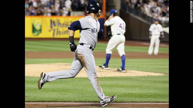 R.A. Dickey, back, number 43, walks to the mound after giving up a home run to the Yankees' Nick Swisher on June 24, 2012, ending Dickey's scoreless-innings streak at 44.2.
