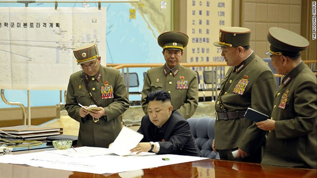 Kim Jong Un is briefed by his generals in this undated photo. On the wall is a map titled &quot;Plan for the strategic forces to target mainland U.S.&quot; 