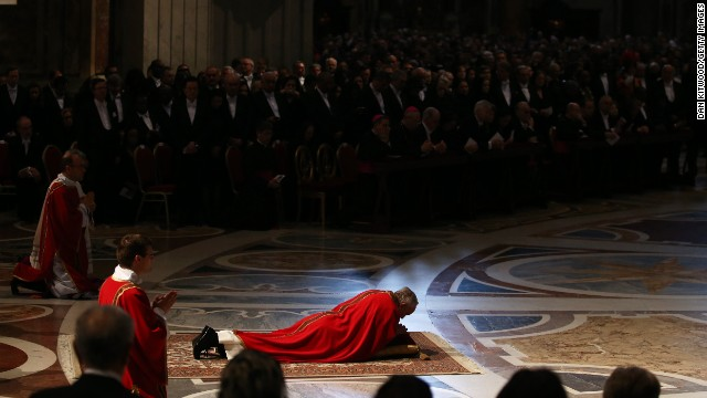 In an act of reverence, Pope Francis lies on floor of St. Peter's Basilica during Mass on Good Friday, in the Vatican.