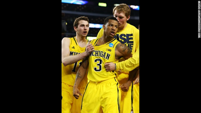 Trey Burke of Michigan, center, and teammates celebrate after Bruke shot the game-tying three pointer in the final seconds of the second half on March 29.