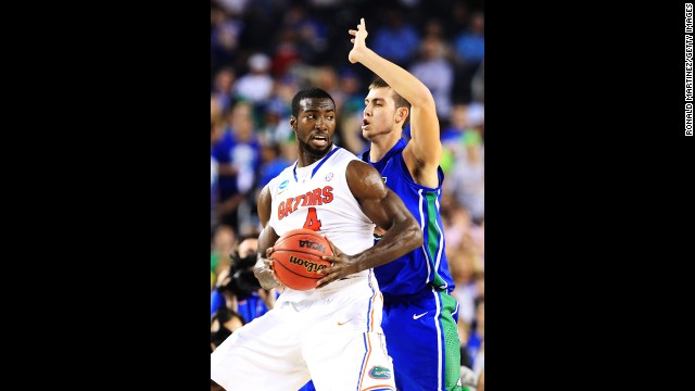 Patric Young of Florida drives against Chase Fieler of Florida Gulf Coast on March 29.